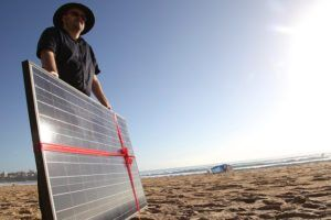 Solar panel gift on Manly beach as Common Grace ask PM Tony Abbott to #acceptthegift of solar for Kirribilli House by Kate Ausburn via Flckr