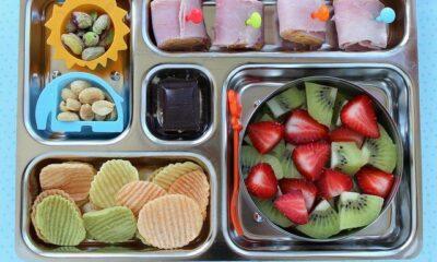 Kindergarten school lunch - ham & cheese rolls, nuts, veggie chips, strawberries and kiwi, organic dark chocolate by Melissa via Flickr