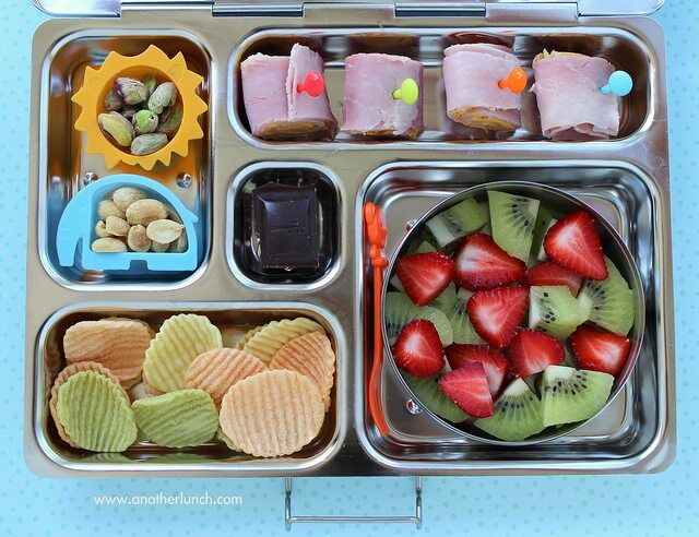 Kindergarten school lunch - ham & cheese rolls, nuts, veggie chips, strawberries and kiwi, organic dark chocolate by Melissa via Flickr