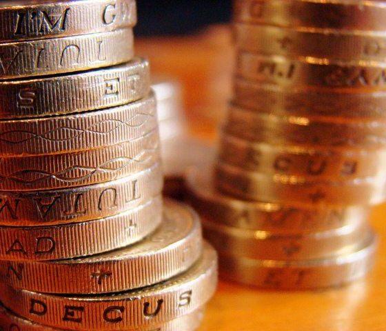 Pound Coins by JD Mack via flickr
