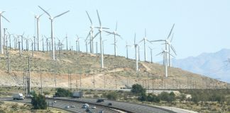 Wind farm and greenhouse gas farm, together by Kevin Dooley via Flickr