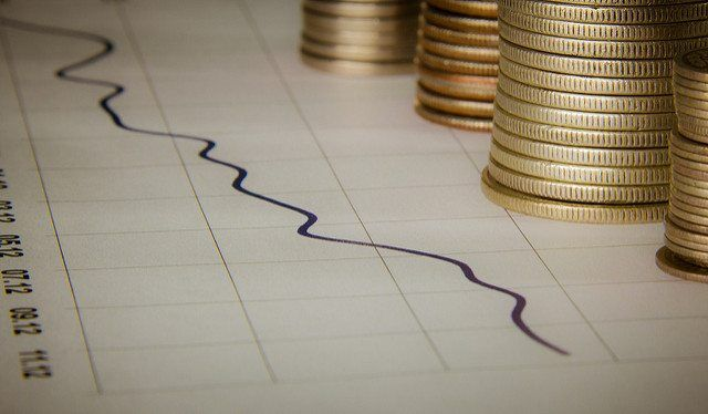 Graph With Stacks Of Coins by Ken Teegardin via flickr