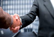 Handshake by corporate traveller via flickr