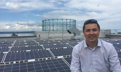 WWF Scotland director Lang Banks visiting rooftop solar installation in Edinburgh