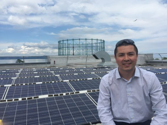 WWF Scotland director Lang Banks visiting rooftop solar installation in Edinburgh