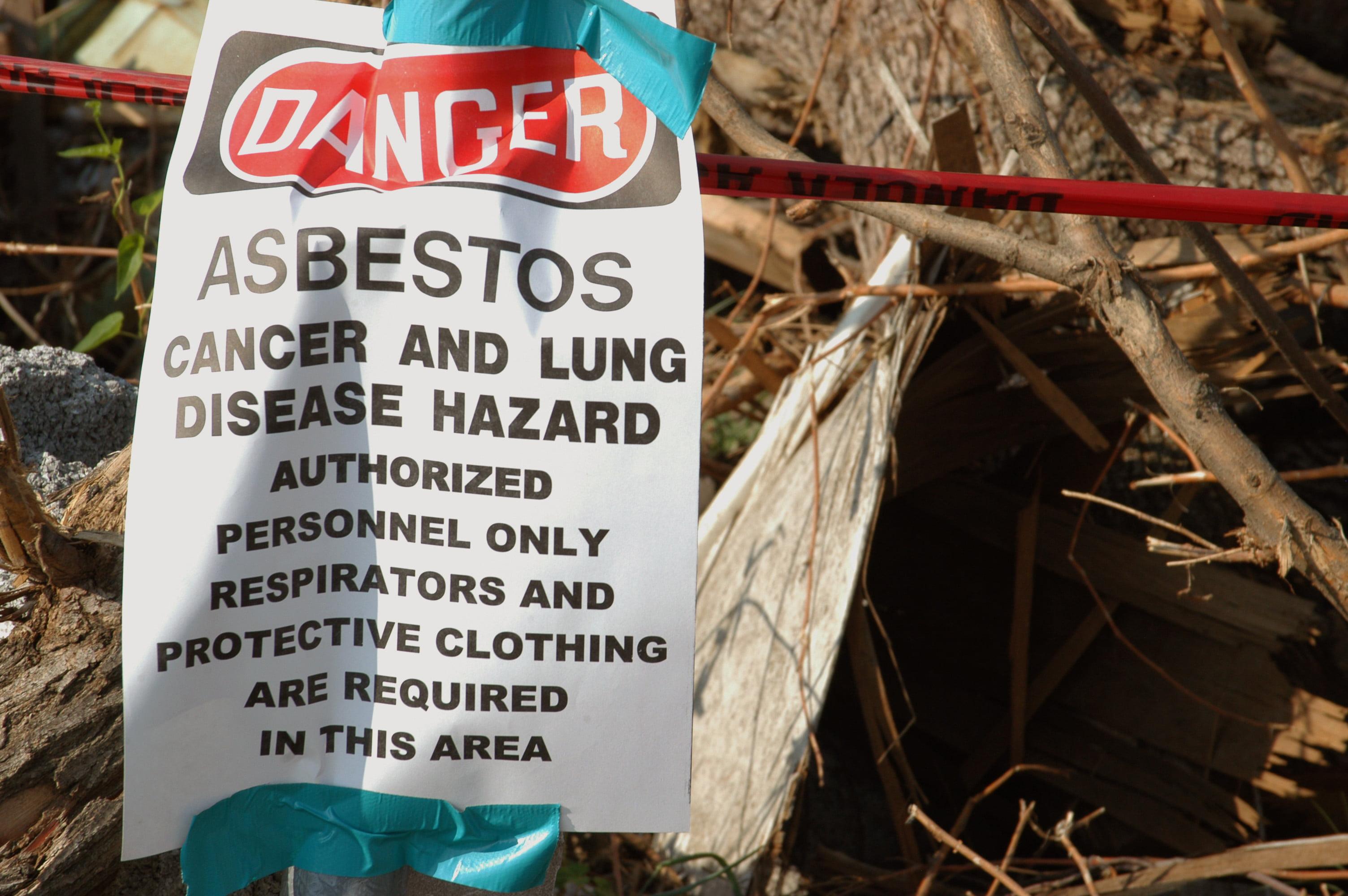 Crews remove asbestos debris