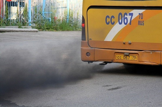 old bus releasing toxic exhaust fumes